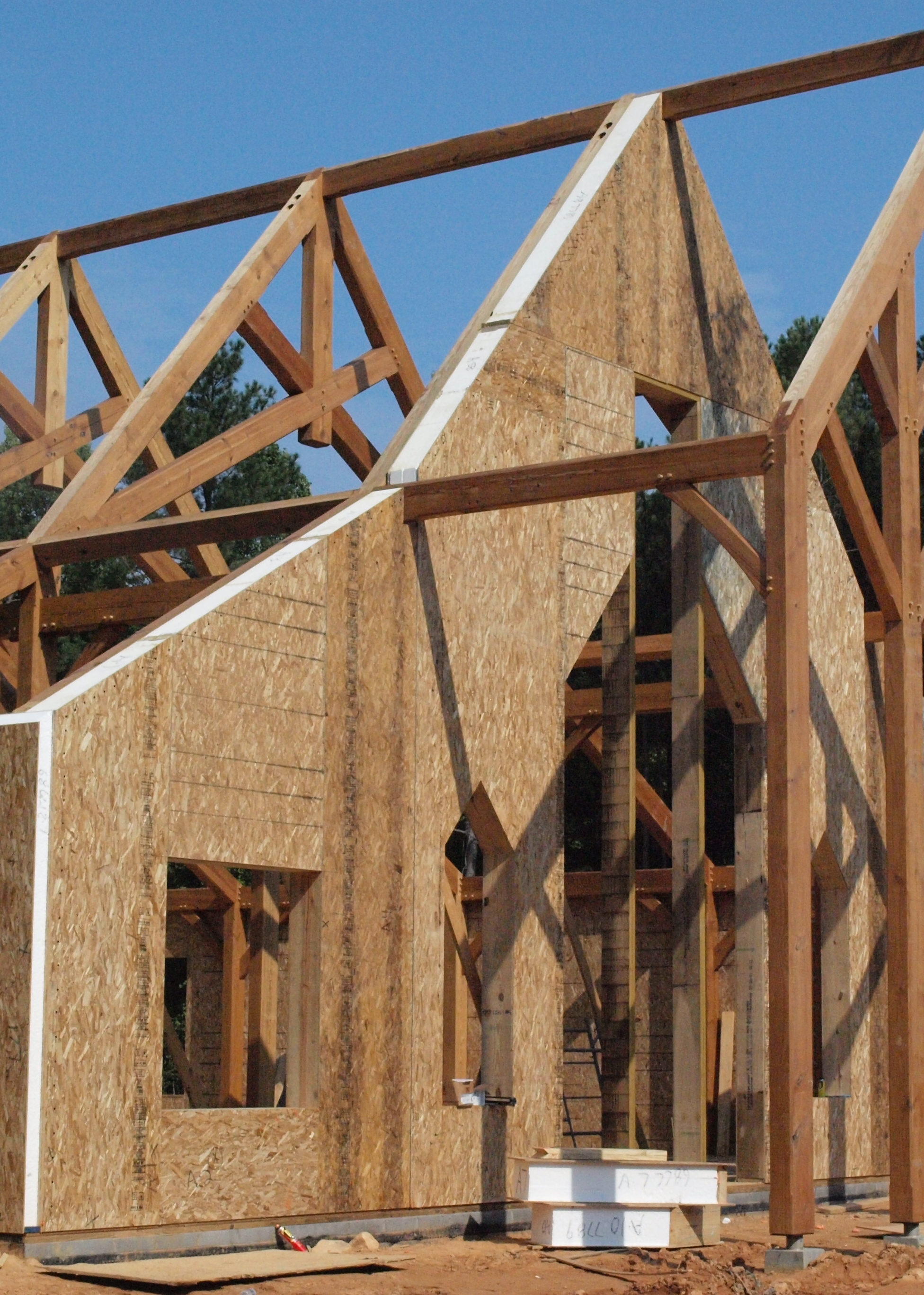 Wrapping a timber frame with structural insulated panels for Sip home construction
