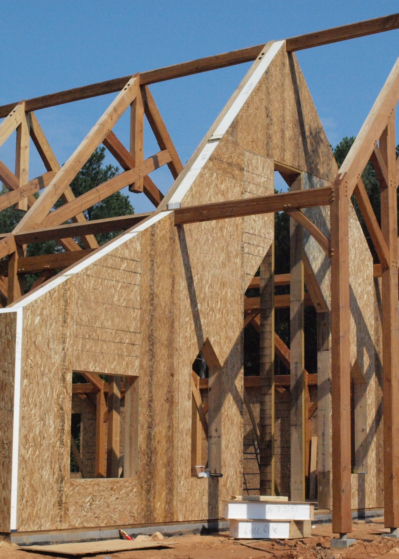 Wrapping a timber frame with structural insulated panels for Building with sip